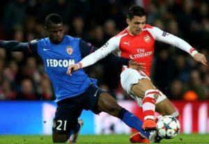 Echiejile battles Arsenal's Alexis Sanchez in last season's UEFA Champions League