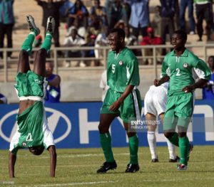 nigerian-julius-aghahowa-jubilates-in-front-of-teammates-isaac-and-picture-id51515521
