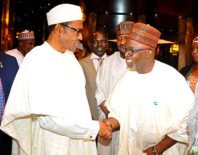 President Muhammadu Buhari gives Pinnick a handshake when he paid courtesy visit with other sports federations in the country
