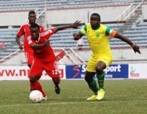Chiamaka Madu of Rangers against Elisha Golbe of Plateau United