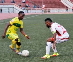 Orji Kalu of Rangers challenges Samuel Mathias of El Kanemi