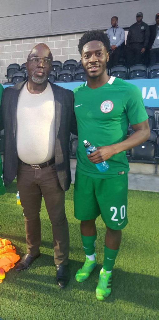 Aina pose with NFF President Amaju Pinnick at the Hives Stadium, London in March