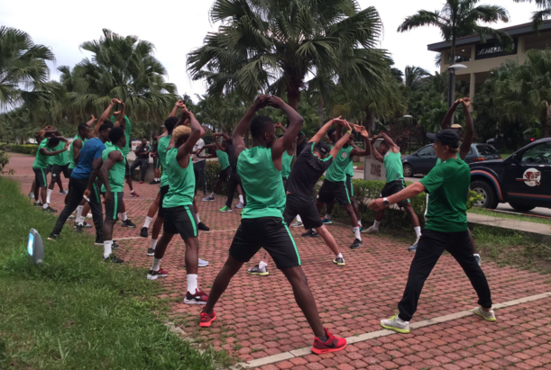 Super Eagles players stretching at the Ibom Le Meridien hotel in Uyo
