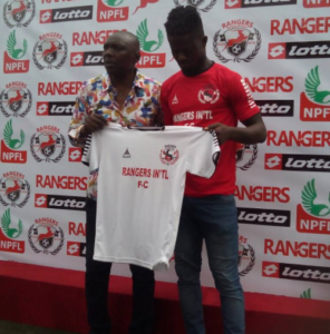 Felix Ogbuke poses with his Rangers jersey alongside David Owumi GM , Enugu Rangers