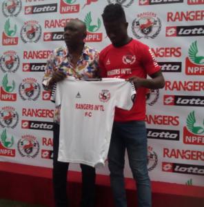 Felix Ogbuke poses with his Rangers jersey alongside David Owumi GM , Enugu Rangers