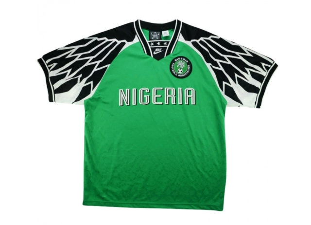 0c6bdaf30b3 ... which features a black and white wing pattern on the shoulder sleeves.  The green used by Nike in 1994 was a little darker
