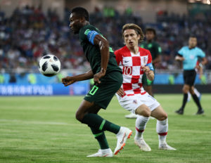 KALININGRAD, RUSSIA - JUNE 16:  John Obi Mikel of Nigeria is challenged by Luka Modric of Croatia  during the 2018 FIFA World Cup Russia group D match between Croatia and Nigeria at Kaliningrad Stadium on June 16, 2018 in Kaliningrad, Russia.  (Photo by Jamie Squire - FIFA/FIFA via Getty Images)