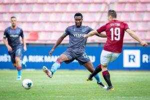 PRAGUE, CZECH REPUBLIC - AUGUST 08: John Obi Mikel (L) of Trabzonspor in action against Lukas Stetina (R) of Sparta Prague during the UEFA Europa League 3rd round soccer match between AC Sparta Praha and Trabzonspor at Generali Arena in Prague, Czech Republic on August 08, 2019. (Photo by Lukas Kabon/Anadolu Agency via Getty Images)