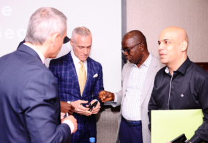 Ted Major, Michael Yormark, Dr. Anene Vice President Abuja Chamber of Commerce networking during the event